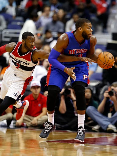 Wizards guard John Wall (2) reaches in to tip the ball