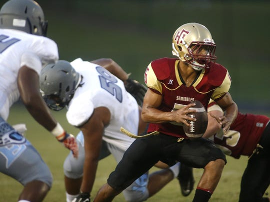 Florida High quarterback Isaiah Hill scrambles out of the pocket against East Gadsden during their game at Florida High on Friday.
