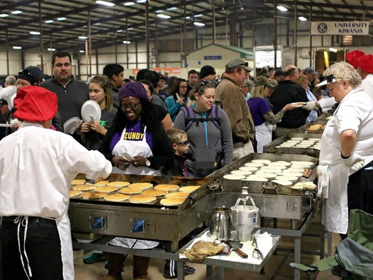 The day starts early for the University Kiwanians on the day of their pancake festival. They report to the J.S. Bridwell Agricultural Center at 4 a.m. to get ready for the hungry crowds.