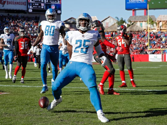 Theo Riddick (25) of the Detroit Lions runs into the end zone for an 18-yard touchdown in the third quarter of a game against the Tampa Bay Buccaneers at Raymond James Stadium on December 10, 2017 in Tampa, Florida. The Lions won 24-21.