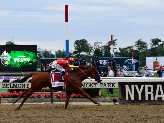 Mike Smith aboard Justify wins the 150th Belmont Stakes
