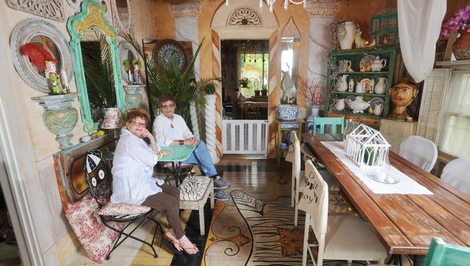 Lucy Valentin and her husband Primo in their dining room. Lucy has used her entire house as a canvas since the couple moved to Zanesville in the early 1990s.