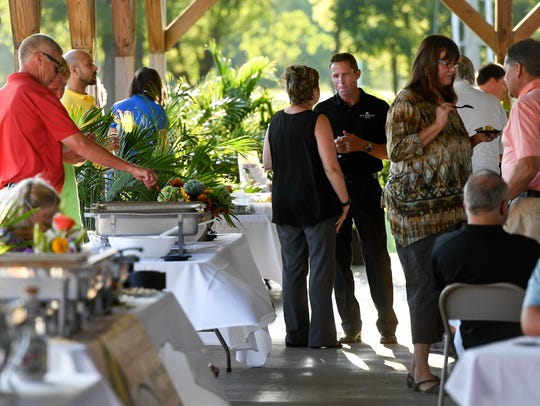 People attend the fourth annual Kyndle Farm to Table