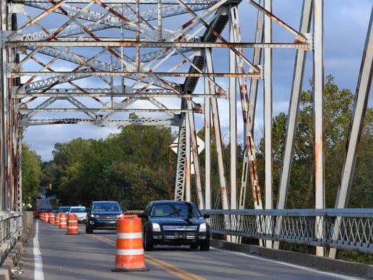 Traffic crossing the 1930's era Spottsville bridge