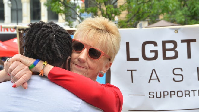 Pastor Judy Hanlon, co-founder of the LGBT Asylum Support Task Force, greets a participant of the 2018 Pride event on Worcester Common.