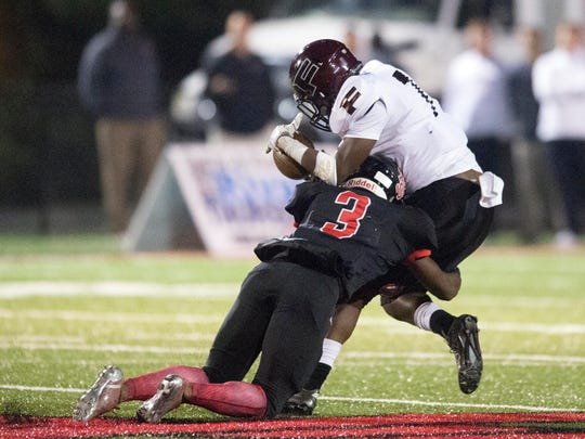 Fulton's Jaquez Booker is tackled by Central's Xavier Washington in the Class 4A playoffs Nov. 18, 2016.