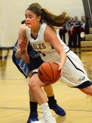 Hartland's Abby Ratkowiak drives toward the basket