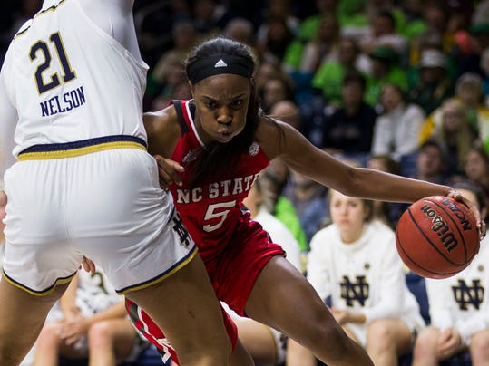 North Carolina State's ChelseaNelson (5) drives around Notre Dame's Kristina Nelson (21) during the first half of an NCAA college basketball game Sunday, Feb. 25, 2018, in South Bend, Ind. (AP Photo/Robert Franklin)