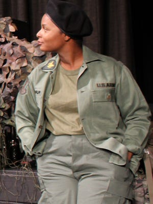 """Kayla Weinkauf plays the part of Steele, an Army intelligence officer in """"A Piece of My Heart,"""" which concludes a two-weekend run at Abilene Community Theatre."""