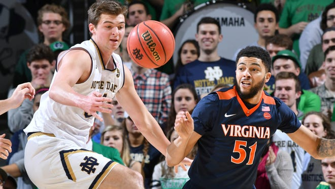 Jan 24, 2017; South Bend, IN, USA; Notre Dame Fighting Irish guard Steve Vasturia (32) loses the ball as Virginia Cavaliers guard Darius Thompson (51) defends in the first half at the Purcell Pavilion. Mandatory Credit: Matt Cashore-USA TODAY Sports