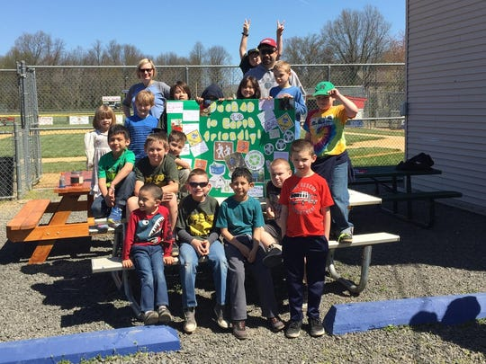 On April 17, 12 scouts from South Bound Brook Cub Scout Pack 42 along with 19 family members met at Franklin Township Little League Field to clean the perimeter and its adjacent areas. After an hour of steady picking up all manner of debris and litter in re-cycled garbage bags, the scouts bundled and tossed their collection in the dumpster behind the dugout. Before going home, scouts and siblings made an Eco Poster for the Environmental Educational Center.  Scout leaders brought supplies and photographs of Pack 42's birdhouses and provided scouts with index cards to record in words or pictures their contributions to help the environment.
