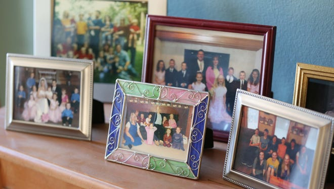 Framed photos of the McCaughey family through the years on display in their home on Sunday, Nov. 8, 2015.