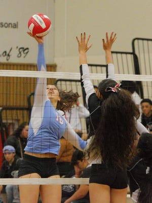 North Salinas High's Esme Nava hits the ball past a Seaside High player during the second set of their match Tuesday.