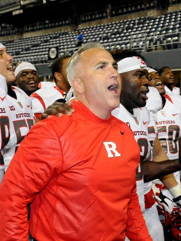 Rutgers Scarlet Knights head coach Kyle Flood sing