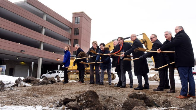 Sioux Falls city officials break ground on Monday at 8th Street and Dakota Avenue on the new city administration building, slated to open in 2018.