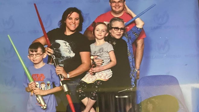 Stacey Richardson and her family met Carrie Fisher, seated, in 2016.