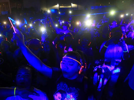 People dance during the silent disco with DJ El Dusty on the second day of Fiesta de la Flor on Saturday, March 25, 2017, in Corpus Christi.