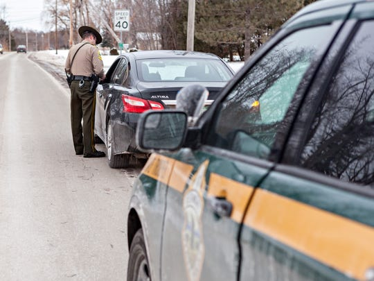 "A real Vermont State Trooper, Jay Riggen, at work in December. The upcoming ""Super Troopers 2"" is a spoof on the police force, as was the original movie."