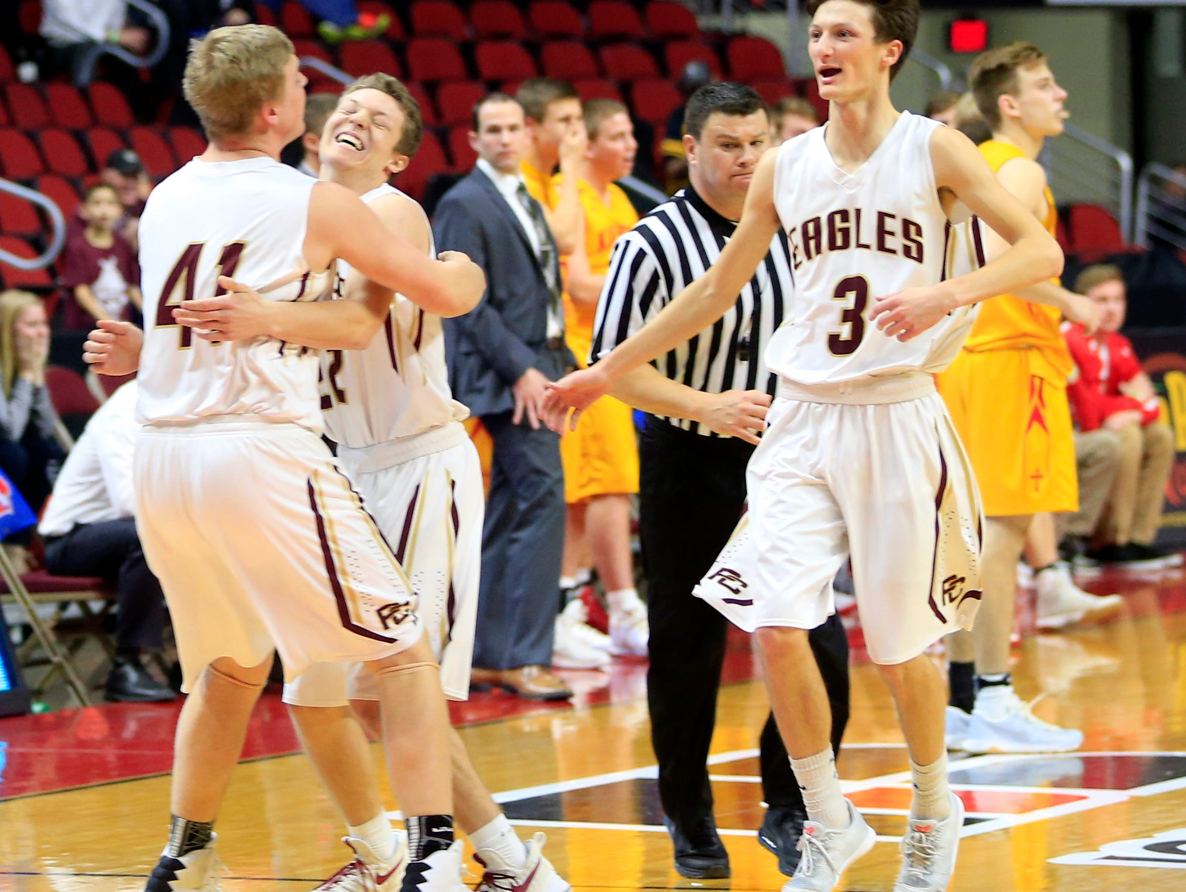 Pella Christian celebrates a win over Kuemper Catholic in the 2A semifinal game Thursday, March 9, 2017.