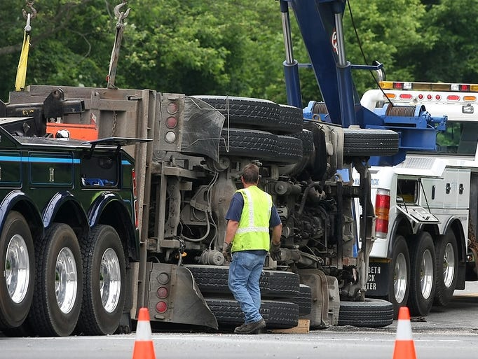 Scene of an overturned dump truck, Tuesday, June 10, 2014, at the intersection of Dey Rd. and Route 130 on the border of Cranbury and South Brunswick, NJ.
