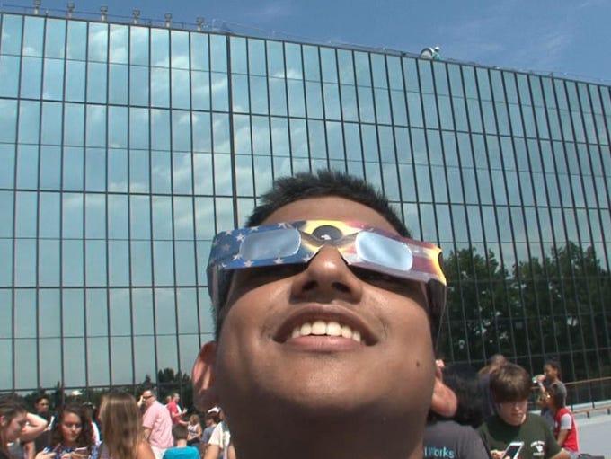 Aruj Jain, 15, Marlboro, watches the solar eclipse