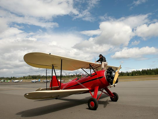 Ken Horwitz, of Old Thyme Aviation, with his 1940 Waco UPF-7 biplane (named Miss Emily) at Bremerton National Airport on Wednesday. Horowitz moved Old Thyme to Bremerton from Seattle's Boeing Field last fall. The company offers flights over Puget Sound and Hood Canal in historic biplanes.