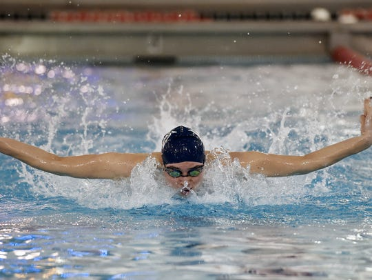 West York's Courtney Harnish swims the 100-yard butterfly