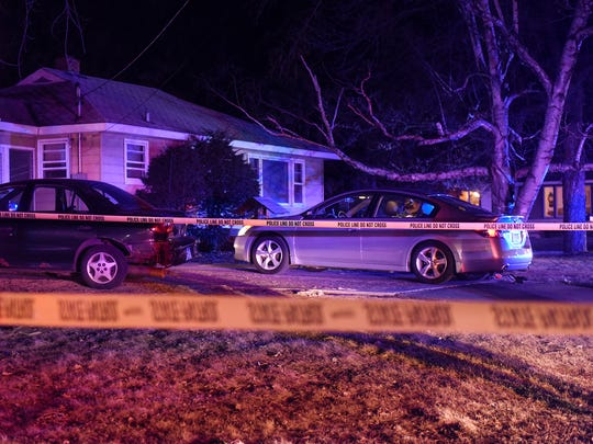 Crime scene tape surrounds a residence Monday, March