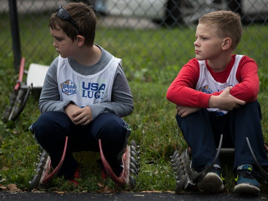 Ten-year-olds Wyatt Grindle, left, and Nicholas Wagner watch luge instruction at Wilbur Shaw Soap Box Derby Hill in Indianapolis.