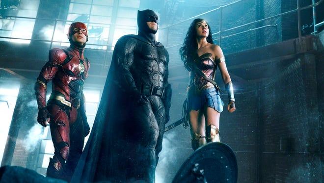 The Flash (Ezra Miller), Batman (Ben Affleck) and Wonder Woman (Gal Gadot) come together in 'Justice League.'