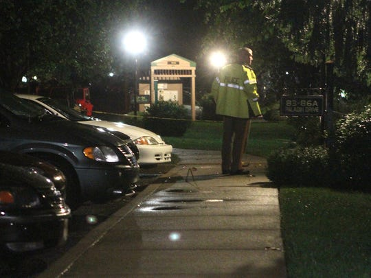 Police investigate at the Paladin Club Condominiums in Fox Point on Sept. 22, 2013, after the killings of Joseph and Olga Connell.