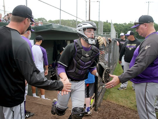 North Kitsap senior catcher Kyle Green hopes to rejoin the baseball team next month. He's recovering from a shoulder injury suffered during football season.