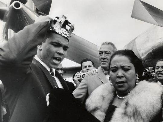 The former Cassius Clay with his mother, Odessa, on