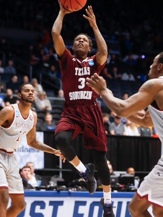 Texas Southern's Demontrae Jefferson (3) shoots against North Carolina Central's Dominique Reid, right, during the first half of a First Four game of the NCAA men's college basketball tournament Wednesday, March 14, 2018, in Dayton, Ohio. (AP Photo/John Minchillo)