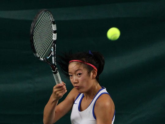 Sarah Yan of Holmdel returns the ball during second single tennis match at Shore Conference Tournament finals on Thursday.