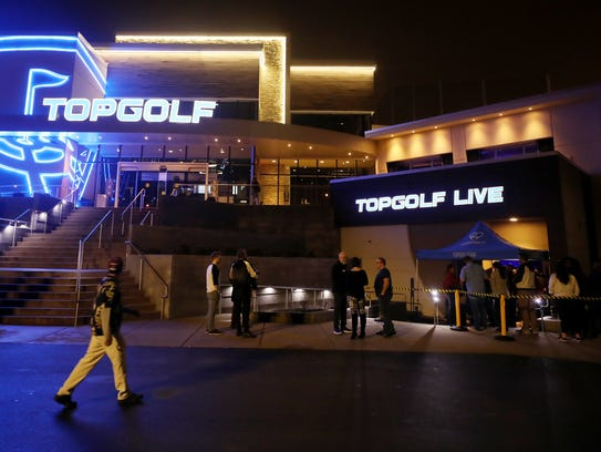 Exterior of Top Golf and The Cowan as fans enter to