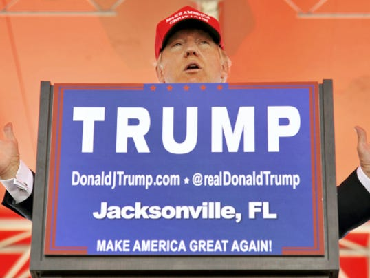Republican presidential candidate Donald Trump speaks from behind a podium at the Jacksonville Landing along the banks of the St. Johns River in Jacksonville, Fla., on Saturday, Oct. 24, 2015. (Bob Self/The Florida Times-Union - Jacksonville.com via AP)