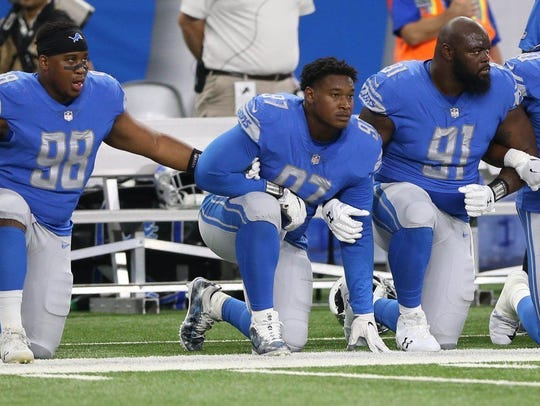 Akeem Spence of the Detroit Lions kneeling during the