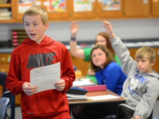 Wrightstown Middle School student Gary Westphal, left, quizzes fellow students during 7th grade language arts on Thursday.