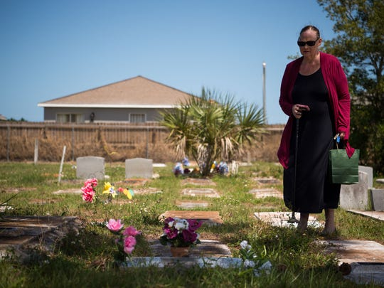 Elaine Amy visits Taneka Wells' gravesite to place