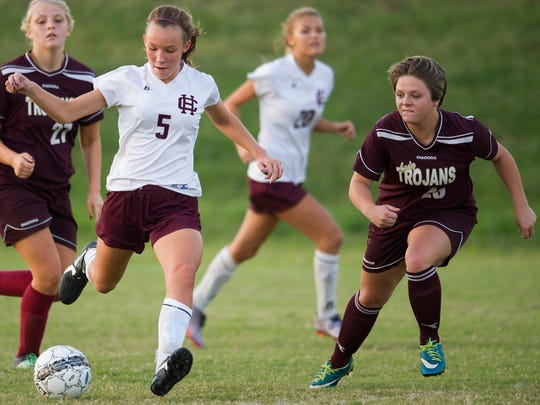 Henderson County's Maddie Griggs (5) scores past Webster County's Kori Main (23) during the Sixth District championship game at Union County High School in Morganfield,  Tuesday, Oct. 11, 2016. Henderson County beat Webster County 11-1.