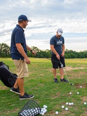 Michael Green, right, and Ryan Sprayberry hits at at