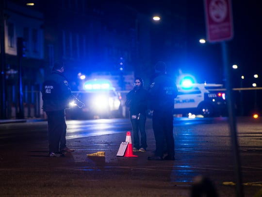 Burlington police investigate the scene of a shooting on Main Street between South Winooski Avenue and Church Street early Monday morning. Police confirmed that one woman was shot and that a suspect was detained and a gun recovered.