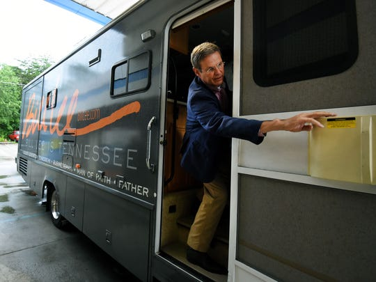 Gubernatorial candidate Bill Lee reaches out to close the door on his campaign RV after a town hall meeting June 28, 2018, at SoKno Market in South Knoxville.