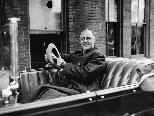 Franklin D. Roosevelt is shown in his car in Albany