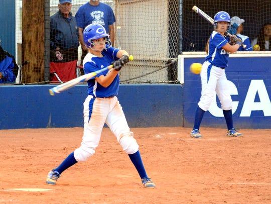 Carlsbad freshman shortstop Jennifer Munro makes contact