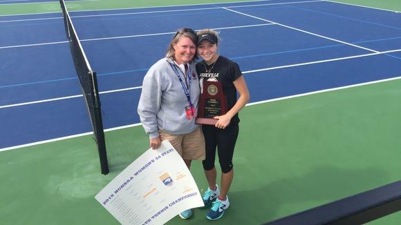 Asheville High tennis coach Erin Mosher and Adrienne Haynes.
