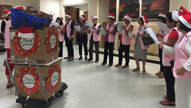 The Guam Memorial Volunteers Association Pink Ladies spread holiday cheer with Christmas carols and gifts on Dec. 18. The association sang carols in various languages and passed out small gifts to the patients throughout the hospital.