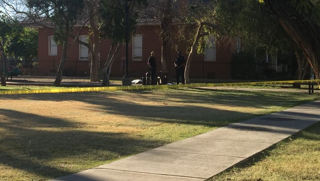 Phoenix police officers are investigating the death of a man found in a park near Third Avenue and Roosevelt Street in Phoenix on Feb. 17, 2016.