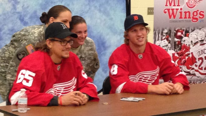 Detroit Red Wings Danny DeKeyser, left, and Justin Abdelkader.